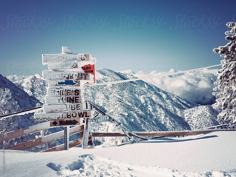 Snow Covered Trail Signs At A Ski Resort by Laura Austin for Stocksy United