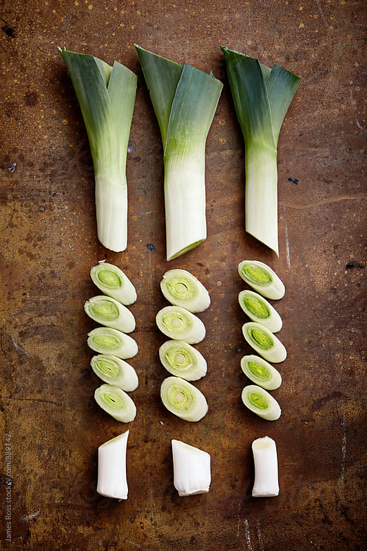 Three leeks cut into sections by James Ross for Stocksy United