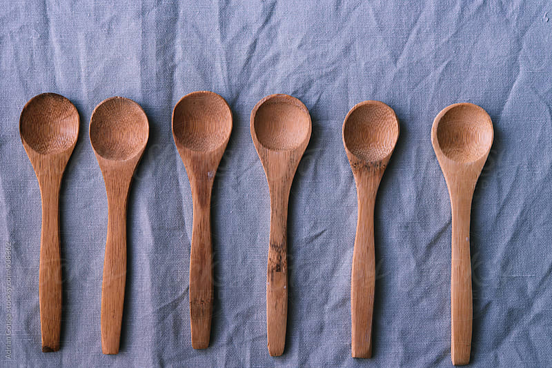 Wooden spoons on a blue backgrownd by Adrian Cotiga for Stocksy United