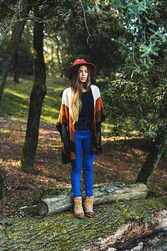 Hipster woman standing in the woods. by BONNINSTUDIO for Stocksy United