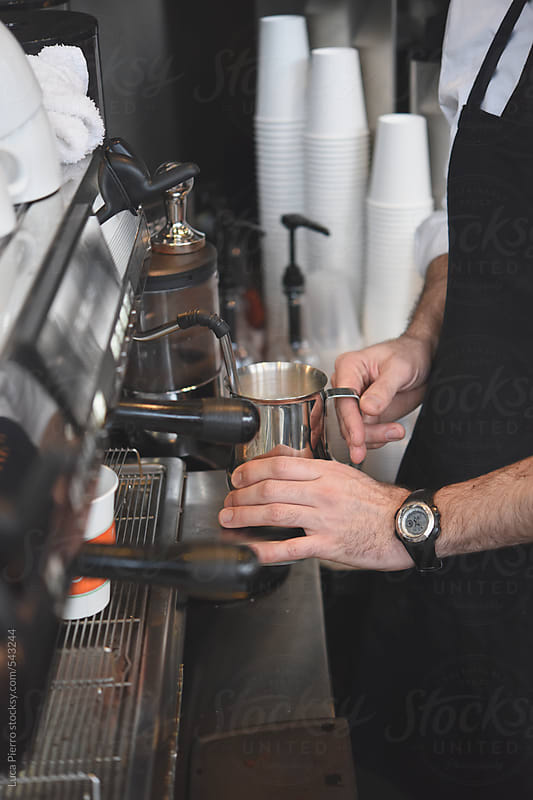 Bartender making an Italian cappuccino by Luca Pierro for Stocksy United