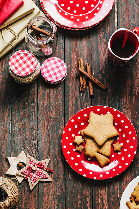 Christmas cookies served in red dish with coffee and christmas decoration by Aleksandar Novoselski for Stocksy United