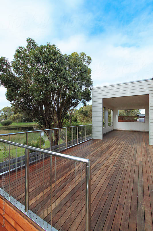 Deck and entertaining area by Rowena Naylor for Stocksy United