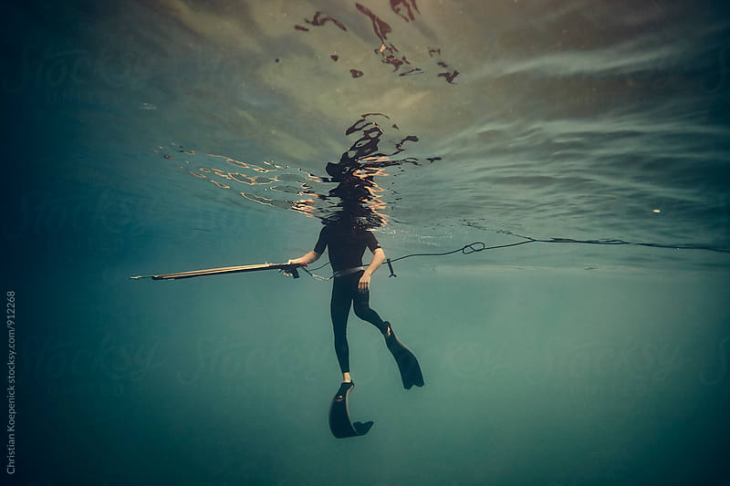 Spearfishing Pacific Wahoo by Christian Koepenick for Stocksy United