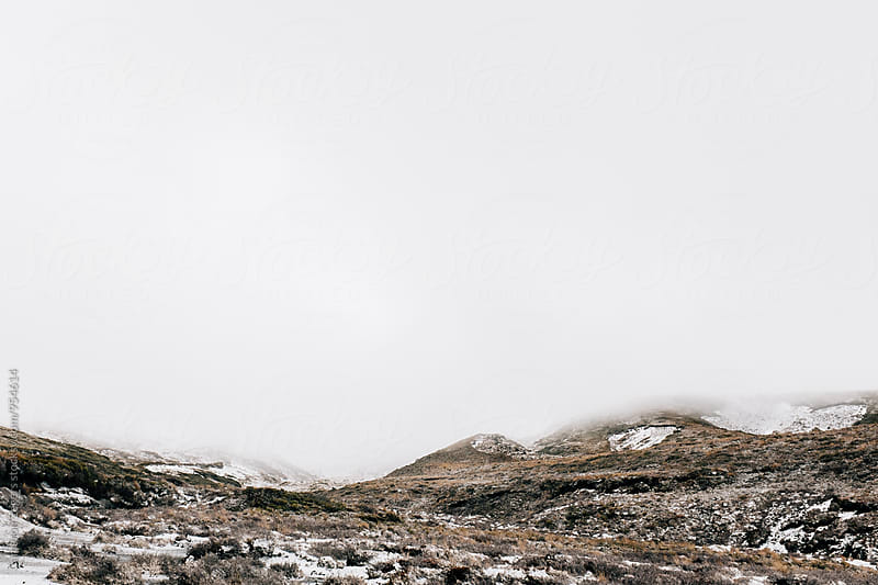 snowy hillside and overcast sky by Cameron Zegers for Stocksy United