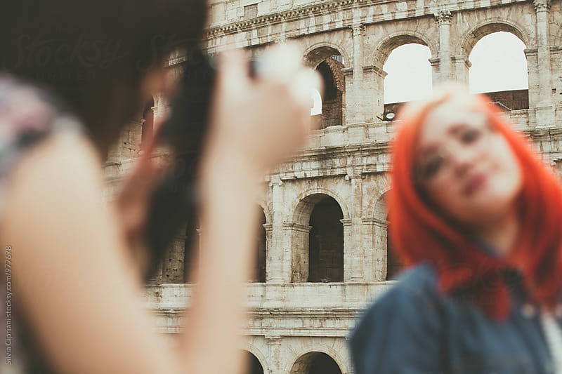 Tourist girl by the Coliseum by Silvia Cipriani for Stocksy United