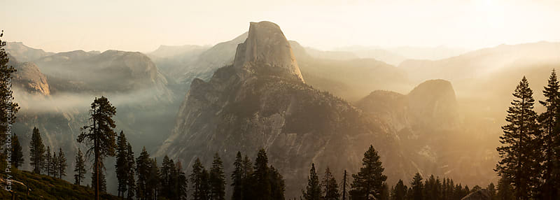 Magical morning sunshine and fog rises over Glacier Point at Yosemite National Park by Gary Parker for Stocksy United
