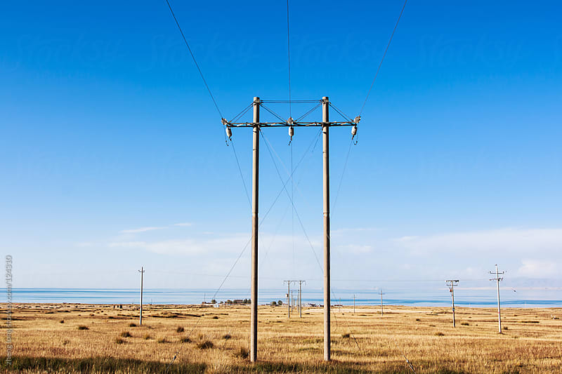 Wire rod beside Qinghai lake  by zheng long for Stocksy United