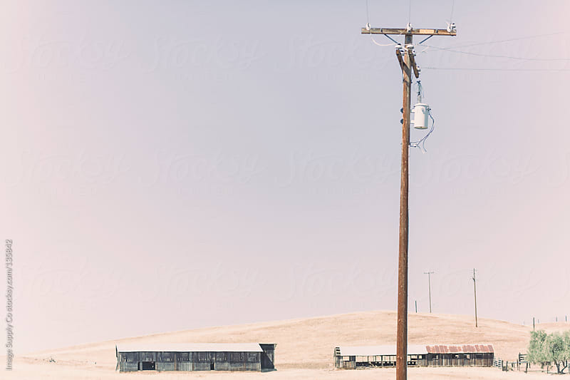 barns and power pole in the country side by Image Supply Co for Stocksy United