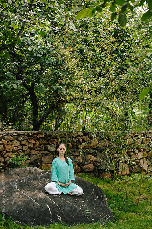 Young woman practicing yoga by MaaHoo Studio for Stocksy United