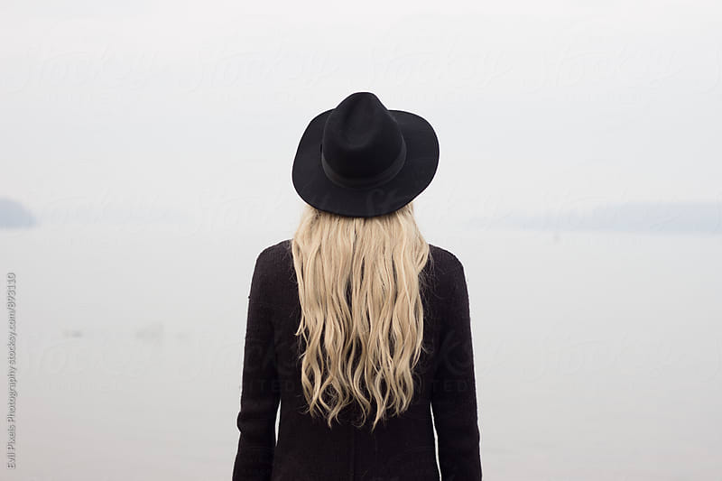 Androgen model with black hat from back by Branislava Živić for Stocksy United