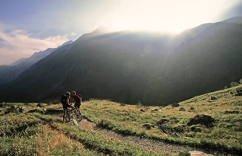 Two mountain bikers riding single track in the mountains by Soren Egeberg for Stocksy United