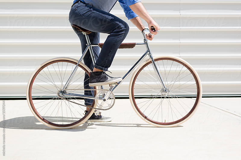 Man on his stylish bicycle by michela ravasio for Stocksy United