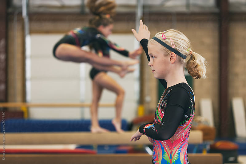 Gymnastics: Team Practicing On Balance Beam For Competition by Sean Locke for Stocksy United