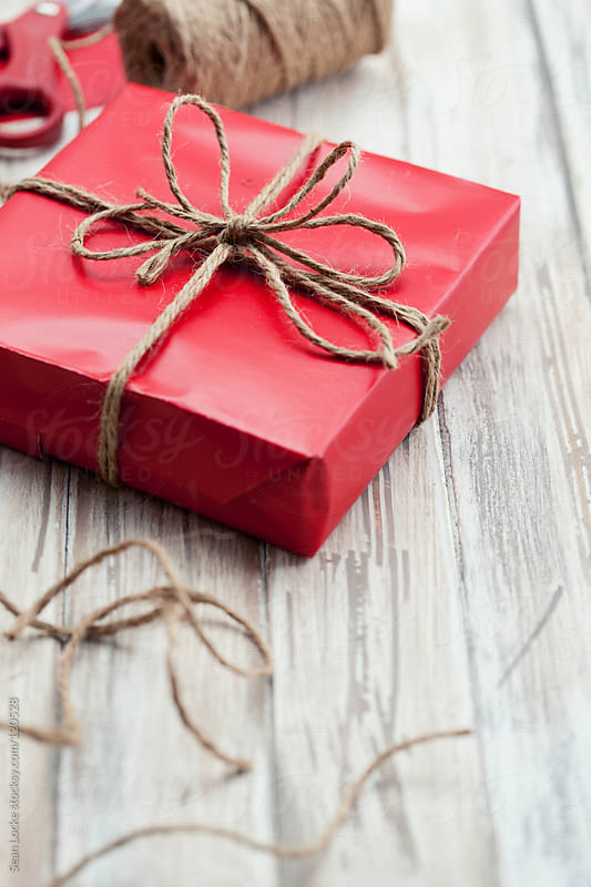 Christmas: Red Wrapped Box with Copyspace by Sean Locke for Stocksy United