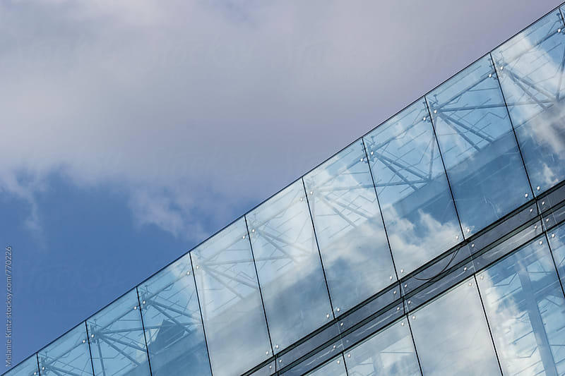 Detail of a modern glass facade by Melanie Kintz for Stocksy United