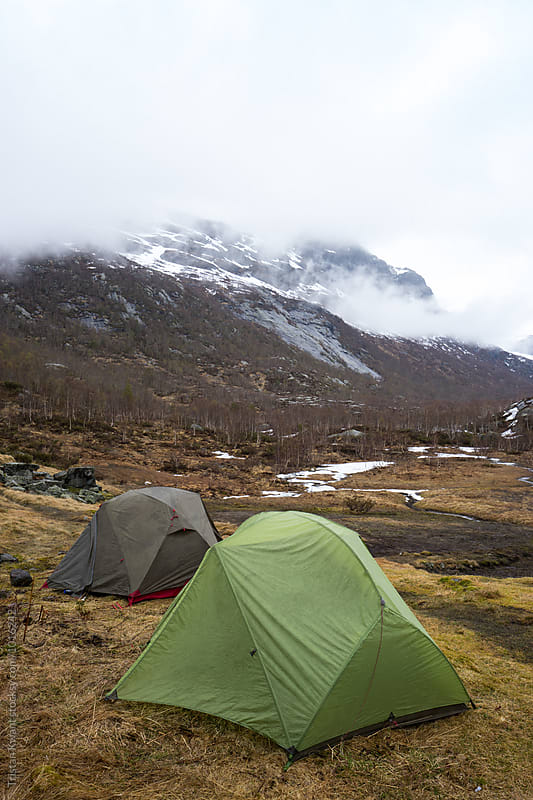 Two tents in the rain. by Tristan Kwant for Stocksy United