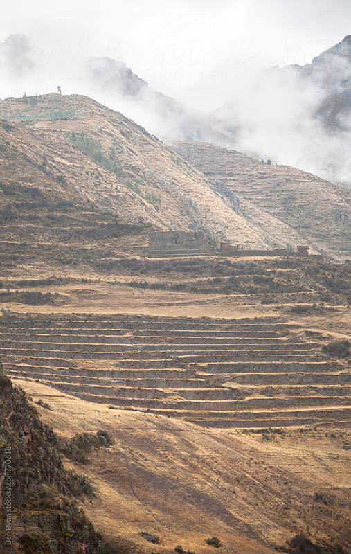Peru: Incan ruins at the top of a terraced mountainside at Pisaq by Ben Ryan for Stocksy United