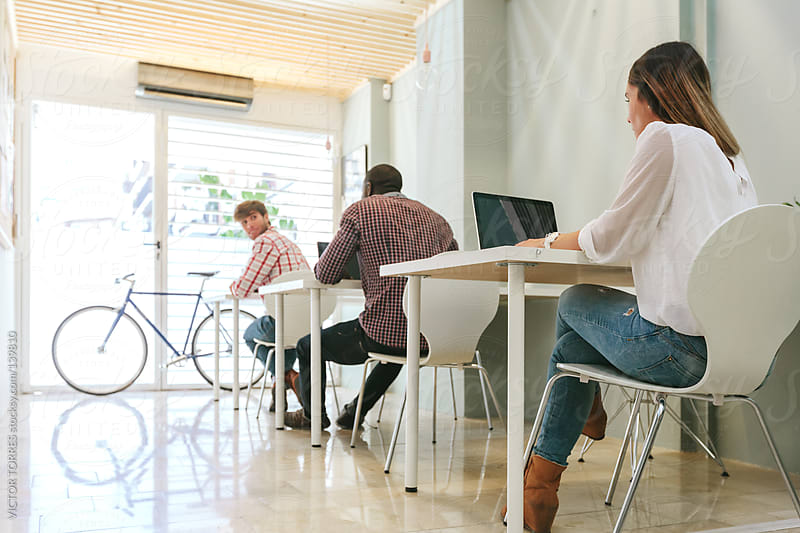 People at a Coworking Office by VICTOR TORRES for Stocksy United