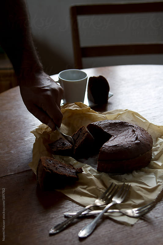 Sliced chocolate cake by Noemi Hauser for Stocksy United