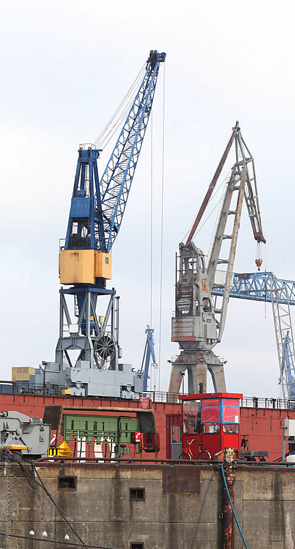 Cranes in the industrial freight harbour of Hamburg by Marcel for Stocksy United