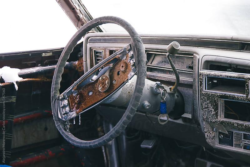 Old car steering wheel frozen with rust by Alejandro Moreno de Carlos for Stocksy United