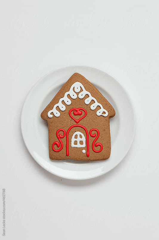 Gingerbread House Cookie On Plate by Sean Locke for Stocksy United