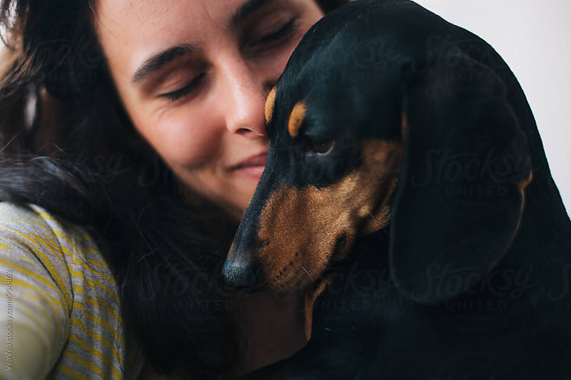 Portrait of a woman with her dog by VeaVea for Stocksy United
