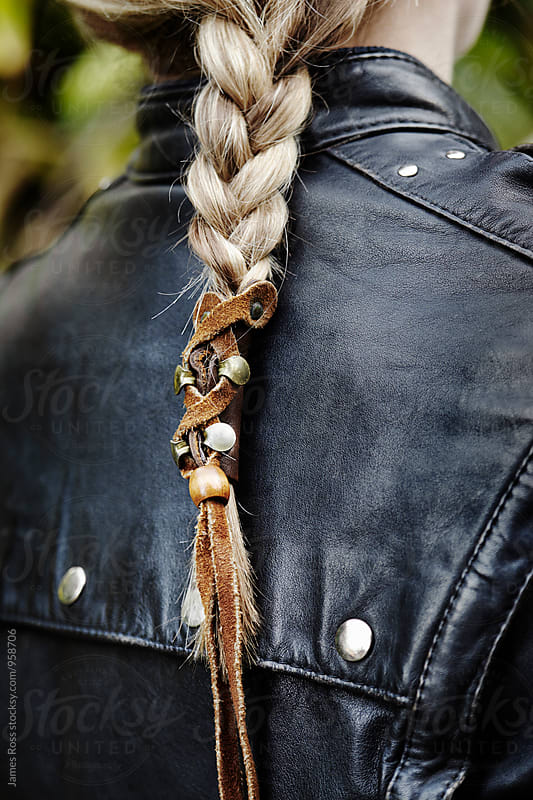 Leather jacket and plaited hair by James Ross for Stocksy United