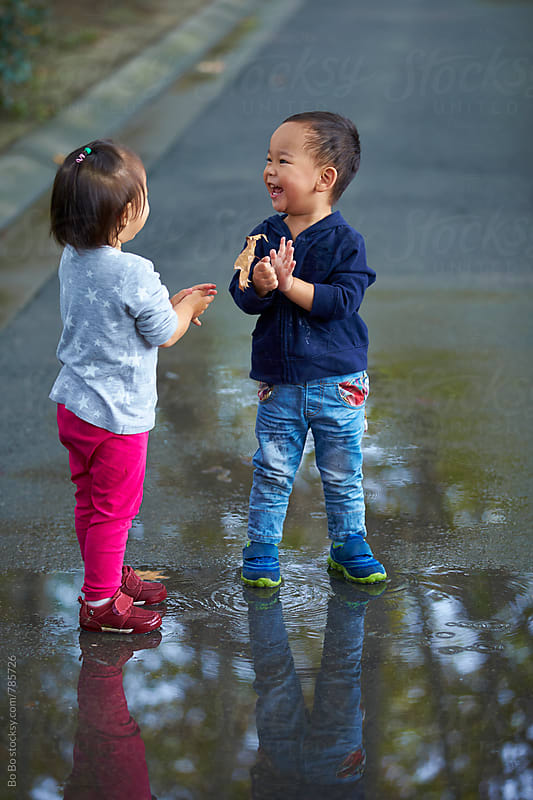 two happy little kids outdoor by Bo Bo for Stocksy United
