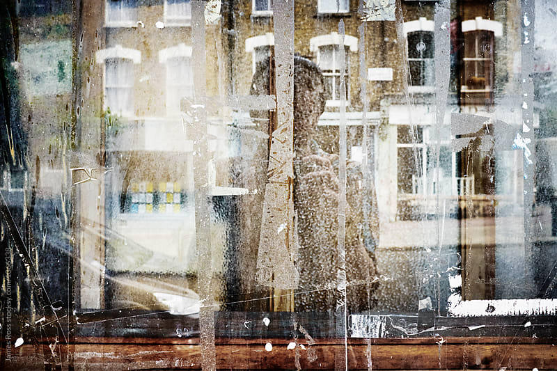 Self Portrait in a window by James Ross for Stocksy United