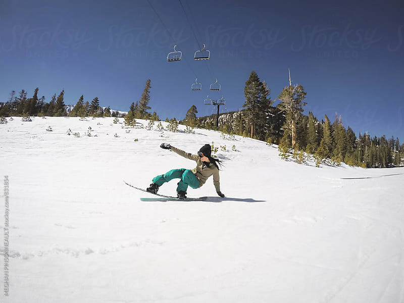 Woman on Snowboard Getting Gnarly with Nose Press  by MEGHAN PINSONNEAULT for Stocksy United