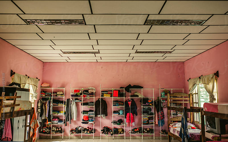 Clothing organizers in a shared room. by Joseph West Photography for Stocksy United