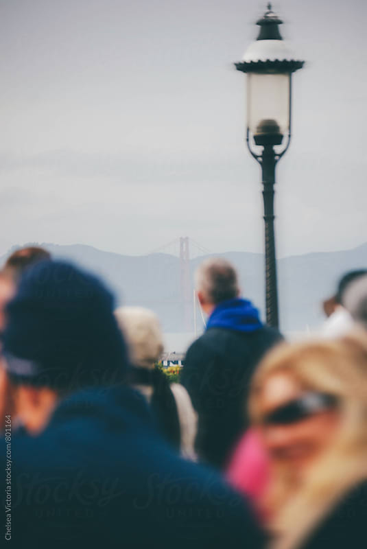 Golden gate bridge with people out of focus by Chelsea Victoria for Stocksy United