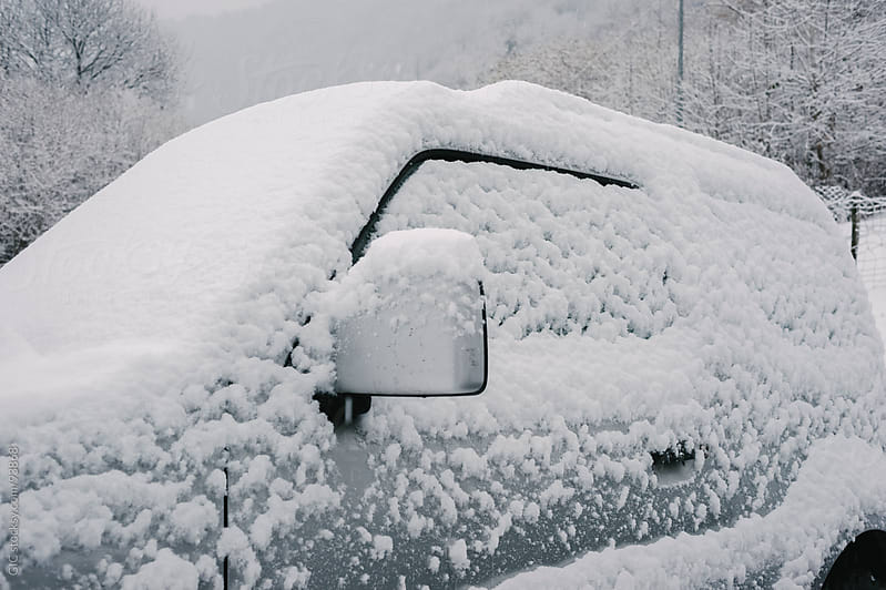 Car covered with snow during winter by GIC for Stocksy United