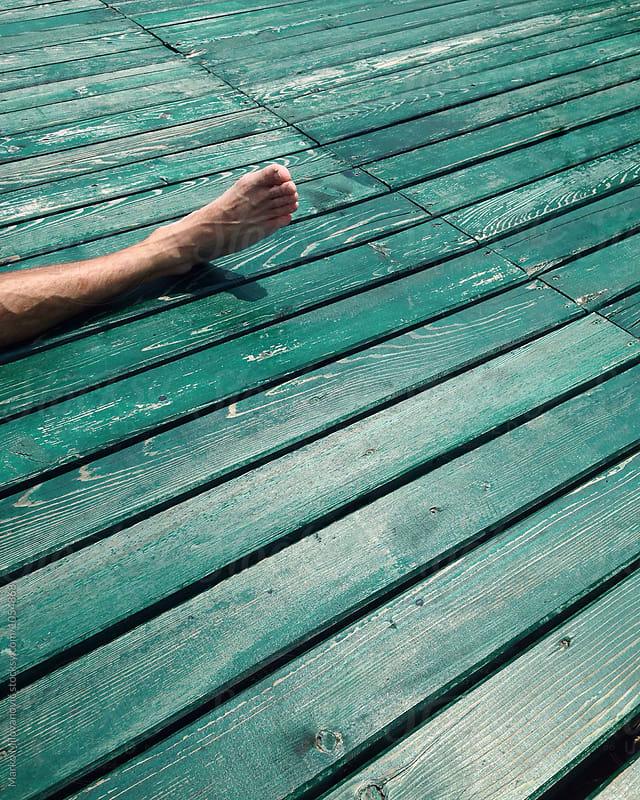Human leg lying by Marko Milovanović for Stocksy United