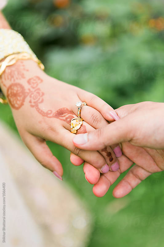 Close up of a couple's hand. by Shikhar Bhattarai for Stocksy United