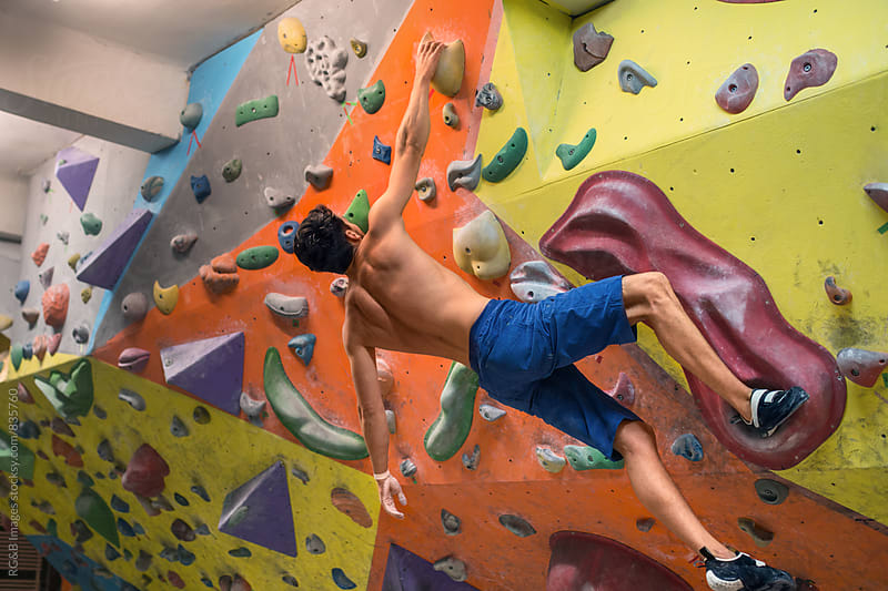 Bouldering on artificial wall by RG&B Images for Stocksy United