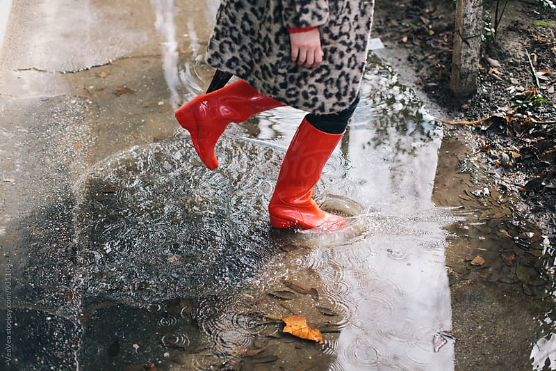 Woman standing in the puddle by Marija Mandic for Stocksy United