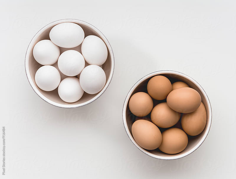 Bowls of white and brown eggs by Pixel Stories for Stocksy United