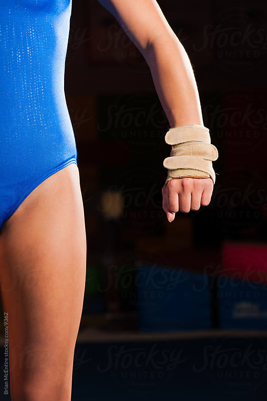 Close-up of determined gymnast by Brian McEntire for Stocksy United