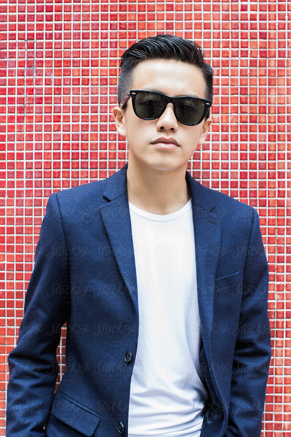 d0a26d403 Portrait of Young Asian Man Wearing Blazer and Black Sunglasses Standing in  Front of Red Wall