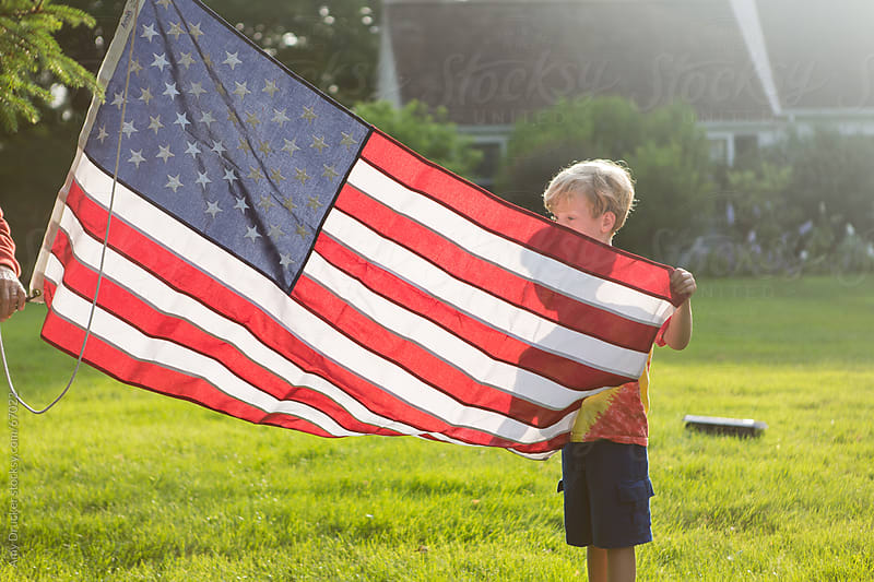 Boy with American Flag by Amy Drucker for Stocksy United