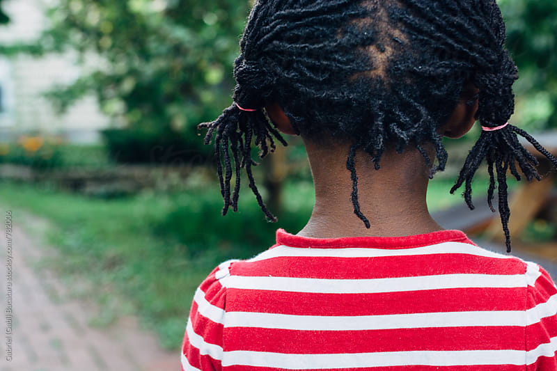 African American girl with pigtails by Gabriel (Gabi) Bucataru for Stocksy United