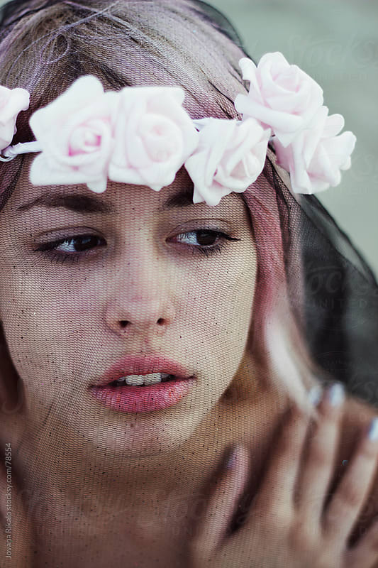 Beautiful girl with flower wreath on her head by Jovana Rikalo for Stocksy United