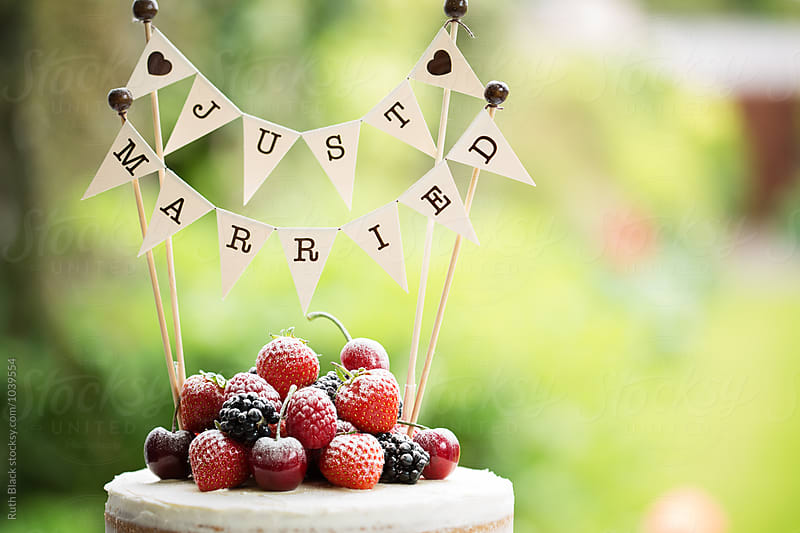Wedding cake with fresh berries by Ruth Black for Stocksy United