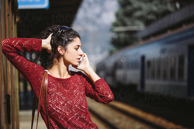 Young woman using her mobile phone by michela ravasio for Stocksy United