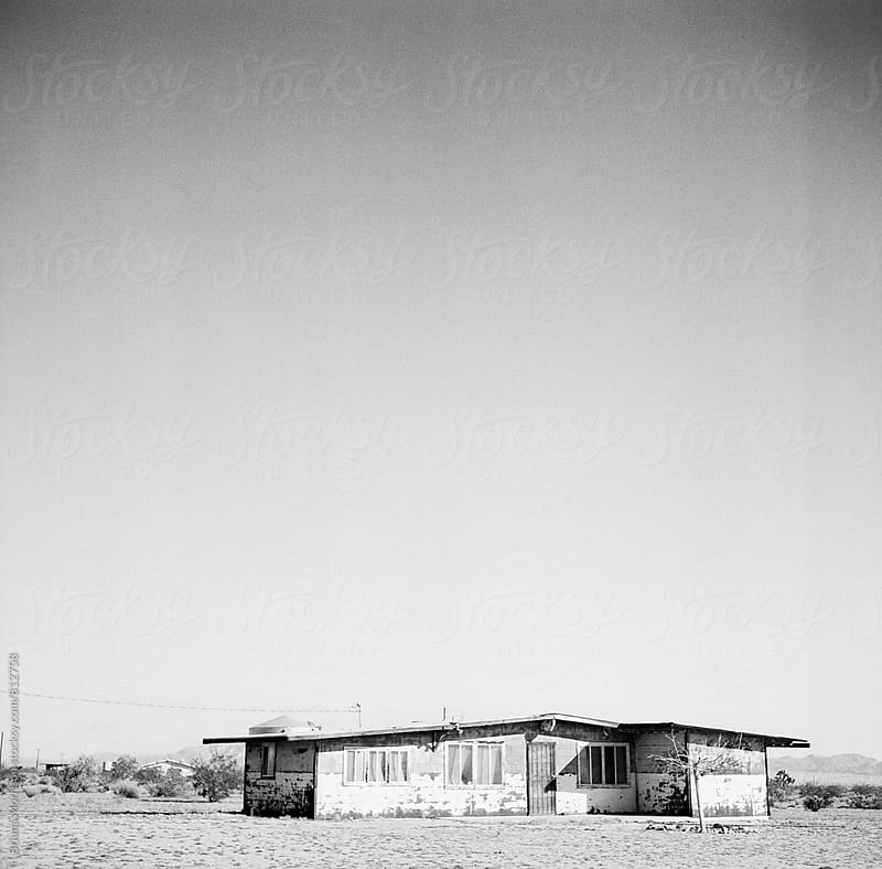 An Old Rundown House in the Desert in Black and White by Briana Morrison for Stocksy United