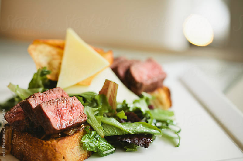 Steak Sandwich with Salad and Cheese by Anjali Pinto for Stocksy United