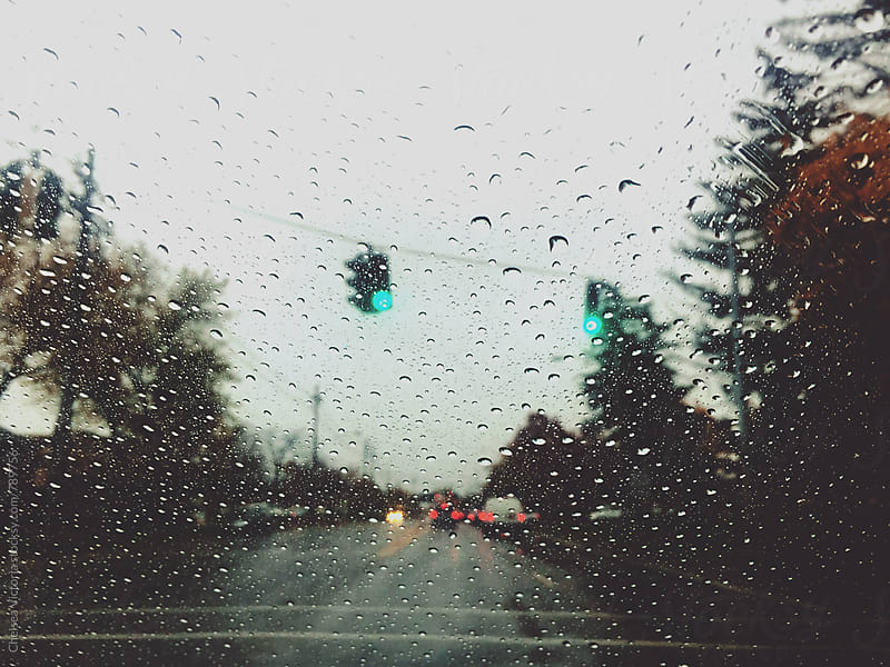 Traffic on a rainy day by Chelsea Victoria for Stocksy United